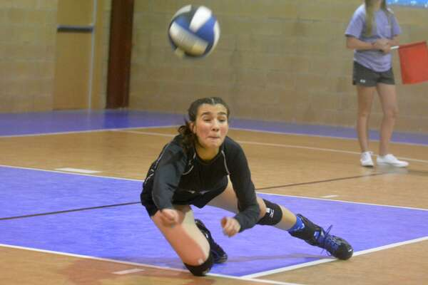 Plainview Christian Academy libero Andrea Lara dives to dig out a hit by Olton during a volleyball match at PCA Tuesday. The Lady Eagles won their third consecutive match to start the season with a three-set victory.