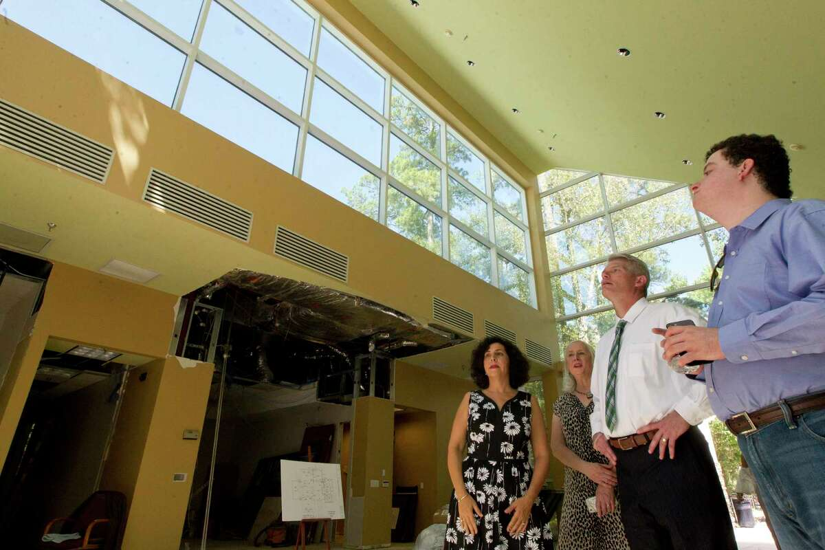 J.J. Hollie, CEO of The Woodlands Area Chamber of Commerce, center, takes in the ongoing renovations of a building for a future fine arts cultural center, Tuesday, Aug. 22, 2017, in The Woodlands. The Glade Arts Foundation is leasing a 7,900 square-foot complex from The Howard Hughes Corporation for the center, which will include a permanent collection from sculptor David Adickes, as well as several exhibitions.