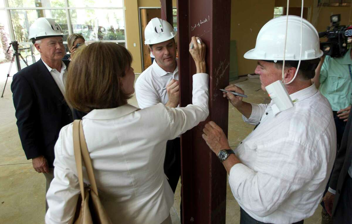 Gordy Bunch, chairman of The Woodlands Township Board of Directors, signs a beam during a renovation ceremony for a fine arts cultural center, Tuesday, Aug. 22, 2017, in The Woodlands. The Glade Arts Foundation is leasing a 7,900 square-foot complex from The Howard Hughes Corporation for the center, which will include a permanent collection from sculptor David Adickes, as well as several exhibitions.