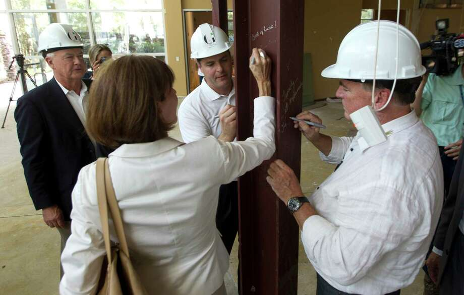 Gordy Bunch, chairman of The Woodlands Township Board of Directors, signs a beam during a renovation ceremony for a fine arts cultural center, Tuesday, Aug. 22, 2017, in The Woodlands. The Glade Arts Foundation is leasing a 7,900 square-foot complex from The Howard Hughes Corporation for the center, which will include a permanent collection from sculptor David Adickes, as well as several exhibitions. Photo: Jason Fochtman, Staff Photographer / © 2017 Houston Chronicle