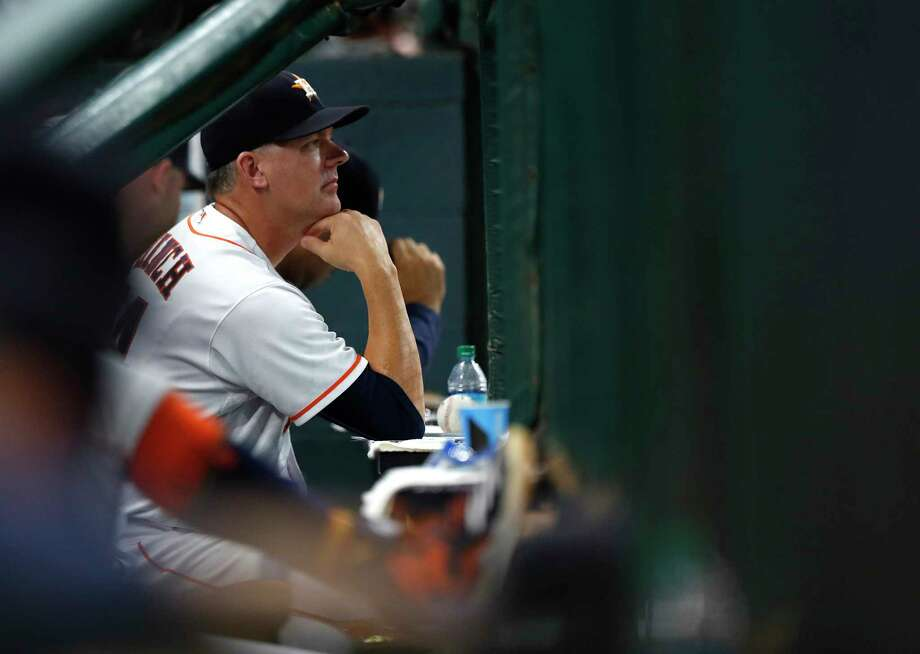 Houston Astros manager A.J. Hinch (14) in the dugout in the second inning of an MLB game at Minute Maid Park, Tuesday, Aug. 22, 2017, in Houston. Photo: Karen Warren, Houston Chronicle / @ 2017 Houston Chronicle
