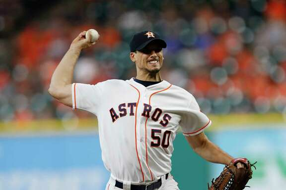 Houston Astros starting pitcher Charlie Morton (50) pitches in the first inning of an MLB game at Minute Maid Park, Tuesday, Aug. 22, 2017, in Houston.