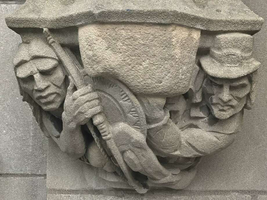 """In this July 20, 2017 photo provided by Yale University, a 1929 doorway carving on the school's New Haven, Conn., campus depicts a Puritan settler, right, with a musket pointing at the head of a Native American, left, which had been covered by workers with removable stone when the seldom-used doorway was converted into a main entrance. A Yale committee charged with assessing potentially offensive art decided to remove it, but will make it available for public display elsewhere so as to not destroy """"reminders of unpleasant history."""" (Yale University via AP) Photo: Associated Press / Yale University"""