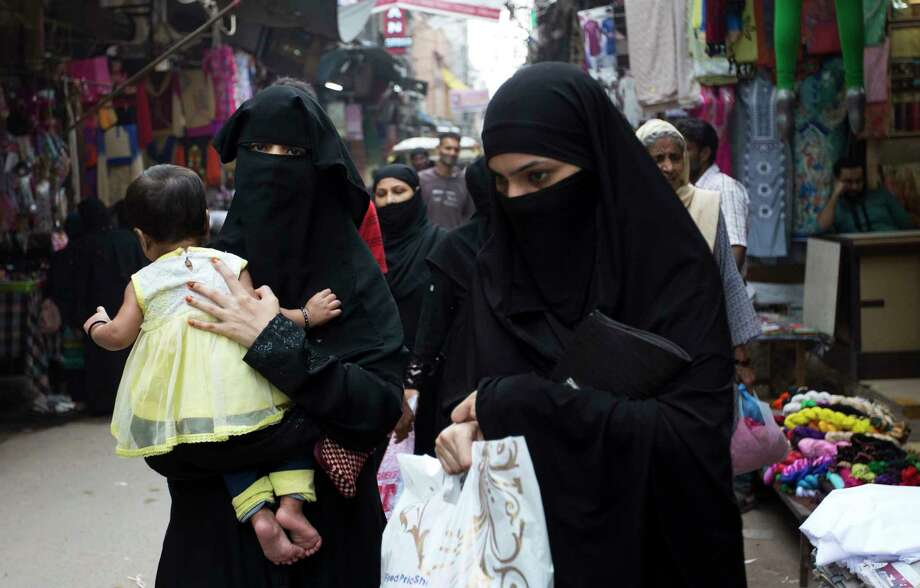 Indian Muslim women walk at a market in New Delhi, India, on Tuesday. India's Supreme Court on Tuesday struck down the practice that allows Muslim men to divorce their wives by saying a word three times. Photo: Tsering Topgyal, STF / Copyright 2017 The Associated Press. All rights reserved.