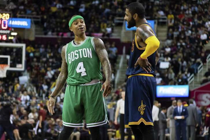 CLEVELAND, OH - NOVEMBER 03: Isaiah Thomas #4 of the Boston Celtics and Kyrie Irving #2 of the Cleveland Cavaliers talk on the court during the first half at Quicken Loans Arena on November 3, 2016 in Cleveland, Ohio. The Cavaliers defeated the 128-122. NOTE TO USER: User expressly acknowledges and agrees that, by downloading and/or using this photograph, user is consenting to the terms and conditions of the Getty Images License Agreement. Mandatory copyright notice. (Photo by Jason Miller/Getty Images)