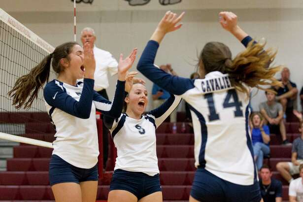 College Park's Mackenzie Nunes (9) celebrates a point during the third set of a non-district volleyball match at Magnolia High School, Tuesday, Aug. 22, 2017, in Magnolia.