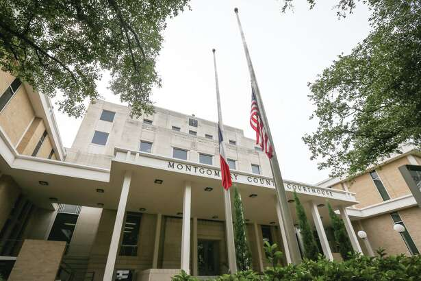 The United States and Texas flags are pictured at half-mast on Monday, Aug. 31, 2015, at the Montgomery County Courthouse.