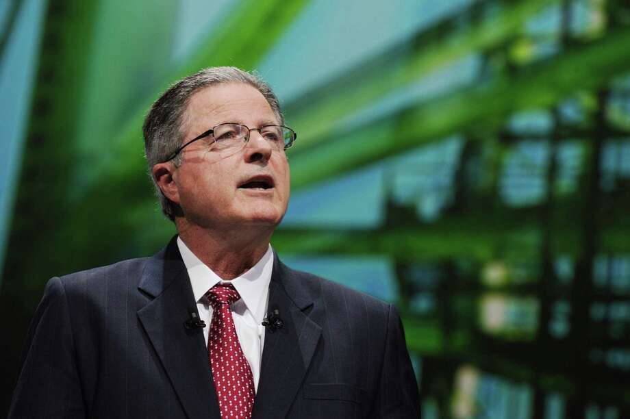 (FILES) This file photo taken on June 2, 2015 shows Chevron Chairman and CEO John Watson as he addresses a keynote speech during the World Gas Conference in Paris. Chevron chief executive John Watson plans to step down as the petroleum industry prepares for a period of lower oil prices, the Wall Street Journal reported on August 22, 2017. A transition would be announced next month. The leading front-runner to replace Watson is executive vice president Mike Wirth, but the plan has not been finalized and could still change, said the newspaper, citing unnamed sources. / AFP PHOTO / ERIC PIERMONTERIC PIERMONT/AFP/Getty Images Photo: ERIC PIERMONT, Contributor / AFP or licensors