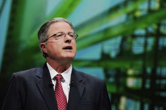 (FILES) This file photo taken on June 2, 2015 shows Chevron Chairman and CEO John Watson as he addresses a keynote speech during the World Gas Conference in Paris. Chevron chief executive John Watson plans to step down as the petroleum industry prepares for a period of lower oil prices, the Wall Street Journal reported on August 22, 2017. A transition would be announced next month. The leading front-runner to replace Watson is executive vice president Mike Wirth, but the plan has not been finalized and could still change, said the newspaper, citing unnamed sources. / AFP PHOTO / ERIC PIERMONTERIC PIERMONT/AFP/Getty Images