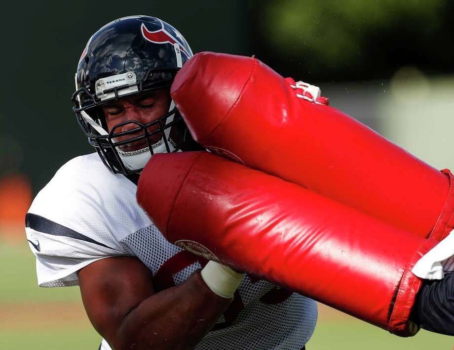 Defensive end Christian Covington, running a drill during practice Tuesday, has found a level of comfort as he approaches his third NFL season. Photo: Brett Coomer, Staff / © 2017 Houston Chronicle}