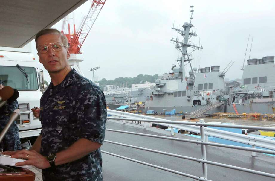 Vice Adm. Joseph Aucoin, Commander of the U.S. 7th Fleet, speaks during a press conference with the damaged USS Fitzgerald as background at the U.S. Naval base in Yokosuka, southwest of Tokyo Sunday, June 18, 2017.  The U.S. destroyer Fitzgerald collided with a container ship in the busy sea off Japan, Saturday. (AP Photo/Eugene Hoshiko) Photo: Eugene Hoshiko, STF / Copyright 2017 The Associated Press. All rights reserved.