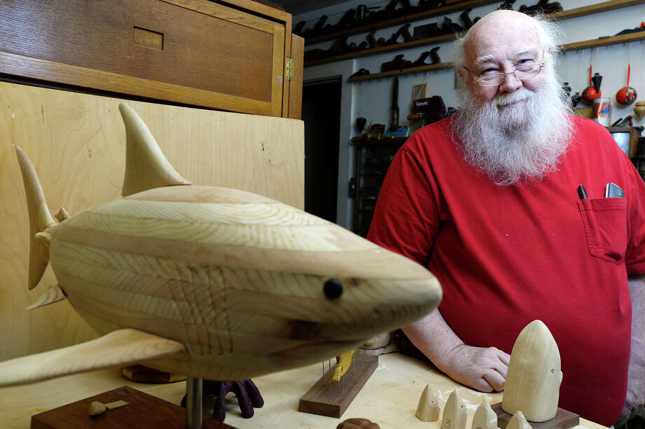 Richard Spinney poses with some of his work in his woodcarving shop at his Beaumont home. Spinney has been carving for over 40 years.  Photo taken Friday 8/11/17 Ryan Pelham/The Enterprise Photo: Ryan Pelham / ©2017 The Beaumont Enterprise/Ryan Pelham