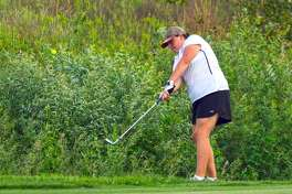 Edwardsville junior Sydney Sahuri chips her shot on to the green on the first hole at Far Oaks Golf Club on Tuesday in Caseyville.