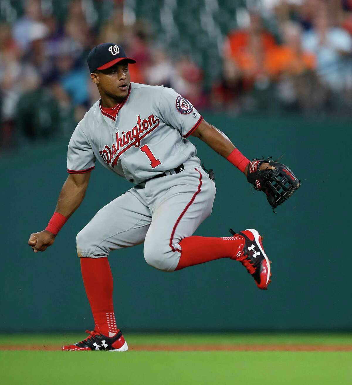 Washington Nationals shortstop Wilmer Difo (1) chases Houston Astros Josh Reddick's RBI single in the third inning of an MLB game at Minute Maid Park, Tuesday, Aug. 22, 2017, in Houston.