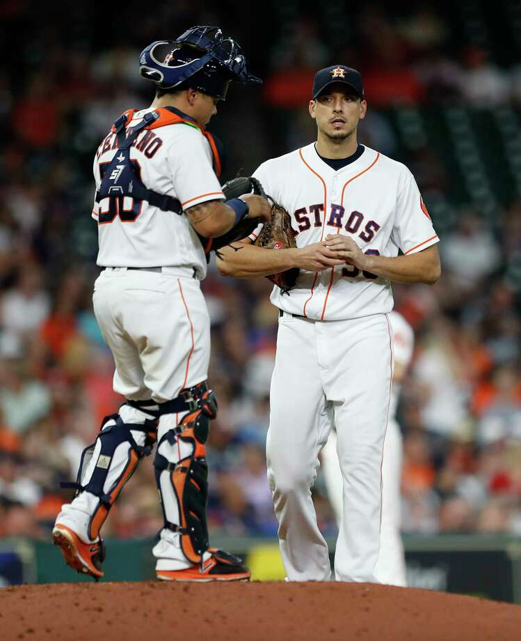 Houston Astros starting pitcher Charlie Morton (50) chats with catcher Juan Centeno (30) after giving up the first hit of the night to Washington Nationals Wilmer Difo in the third inning of an MLB game at Minute Maid Park, Tuesday, Aug. 22, 2017, in Houston. Photo: Karen Warren, Houston Chronicle / @ 2017 Houston Chronicle