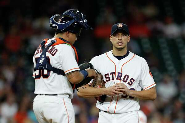 Houston Astros starting pitcher Charlie Morton (50) chats with catcher Juan Centeno (30) after giving up the first hit of the night to Washington Nationals Wilmer Difo in the third inning of an MLB game at Minute Maid Park, Tuesday, Aug. 22, 2017, in Houston.