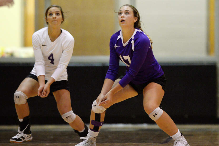 Midland Classical's Allision Shelby (4) and Jenny Coco (17) prepare for an incoming serve from Colorado City on Aug. 22, 2017, at MCA. James Durbin/Reporter-Telegram Photo: James Durbin