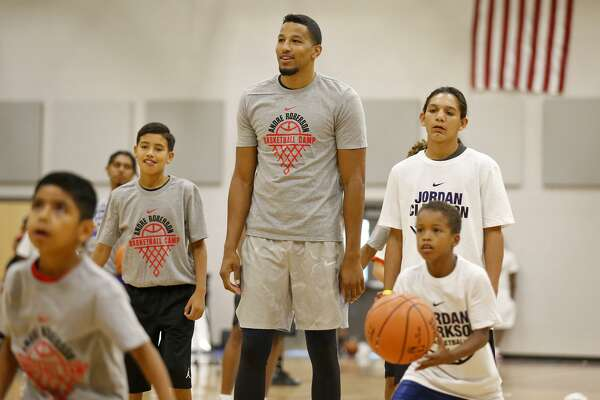 Oklahoma City Thunder's Andre Roberson shoots baskets during a dual basketball clinic with Los Angeles Lakers' Jordan Clarkson (not pictured) on Aug. 4, 2017 at Veterans Memorial High School in San Antonio.