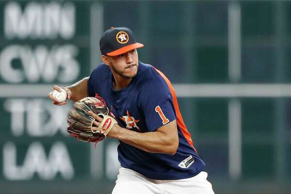 Carlos Correa works out with the team during batting practice before the start of an MLB game at Minute Maid Park, Tuesday, Aug. 22, 2017, in Houston.  ( Karen Warren / Houston Chronicle )
