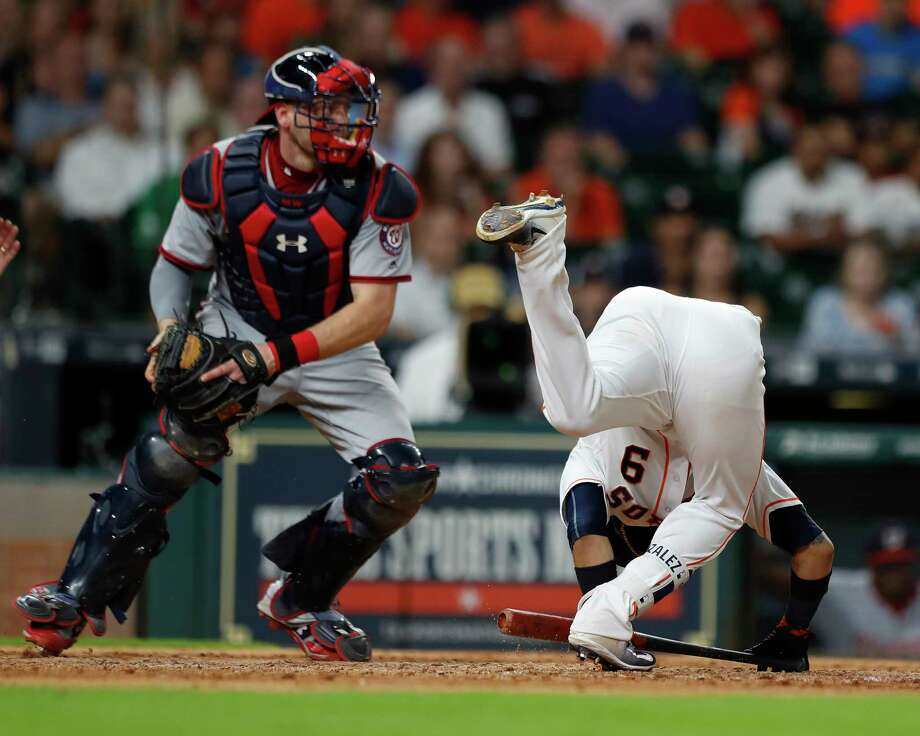 Marwin Gonzalez takes a tumble while batting in the eighth inning Tuesday night, when the Astros squandered a bases-loaded opportunity. Photo: Karen Warren, Staff Photographer / @ 2017 Houston Chronicle