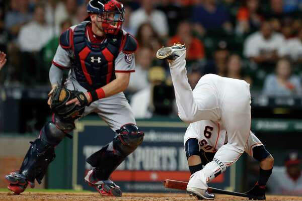 Marwin Gonzalez takes a tumble while batting in the eighth inning Tuesday night, when the Astros squandered a bases-loaded opportunity.