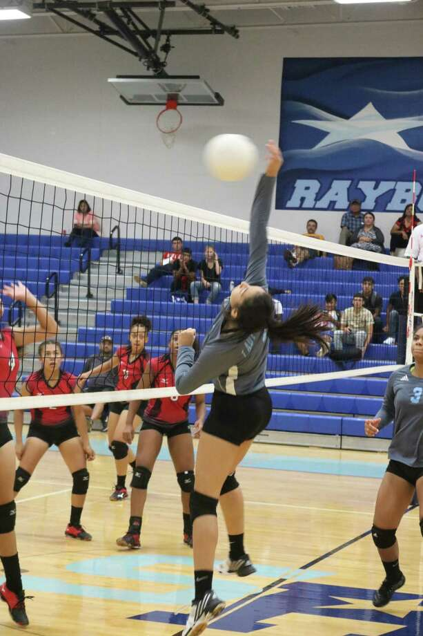 Bianca Segoviano blocks a MacArthur ball during Tuesday night's match. Segoviano enjoyed a very nice match, especially in the all-important fifth game when she  recorded four kills. Photo: Robert Avery