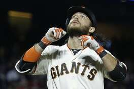 San Francisco Giants' Brandon Crawford celebrates after hitting a two-run home run off Milwaukee Brewers' Jimmy Nelson during the fifth inning of a baseball game Tuesday, Aug. 22, 2017, in San Francisco. (AP Photo/Ben Margot)