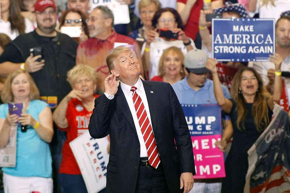 PHOENIX, AZ - AUGUST 22:  U.S. President Donald Trump gestures during a rally at the Phoenix Convention Center on August 22, 2017 in Phoenix, Arizona. An earlier statement by the president that he was considering a pardon for Joe Arpaio,, the former sheriff of Maricopa County who was convicted of criminal contempt of court for defying a court order in a case involving racial profiling, has angered Latinos and immigrant rights advocates.  (Photo by Ralph Freso/Getty Images)