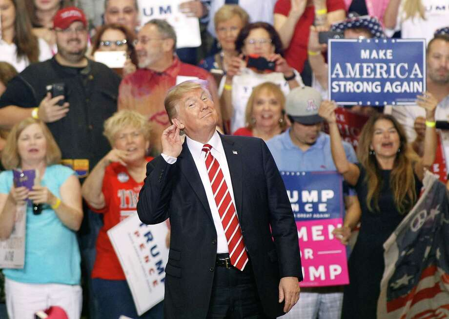 President Donald Trump gestures during a rally at the Phoenix Convention Center on Aug. 22 in Phoenix, Arizona. The president hinted that he was considering a pardon for Joe Arpaio,, the former sheriff of Maricopa County who was convicted of criminal contempt of court for defying a court order in a case involving racial profiling. Photo: Ralph Freso /Getty Images / 2017 Getty Images