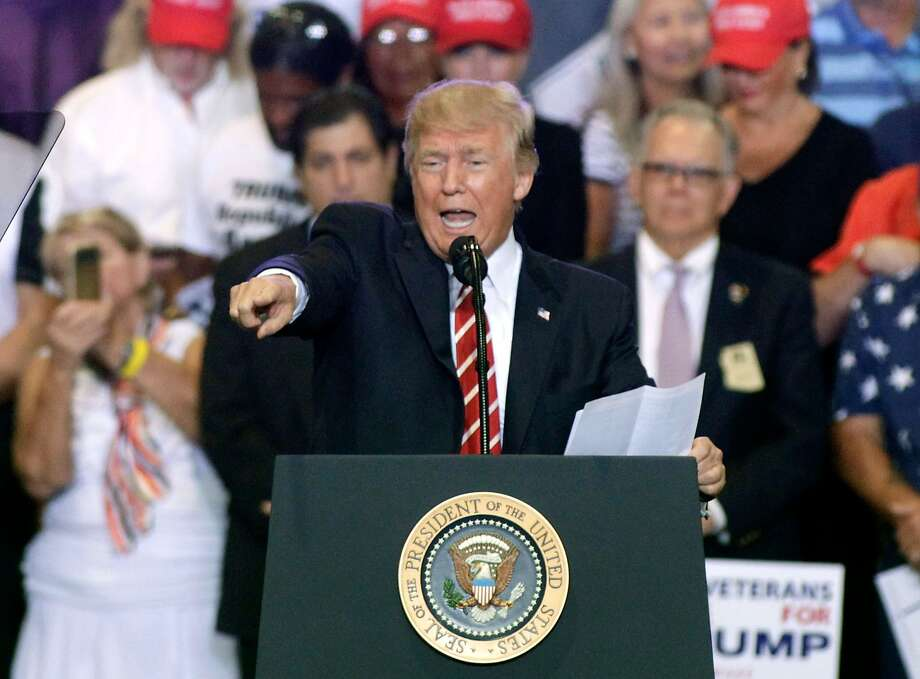 PHOENIX, AZ - AUGUST 22:  U.S. President Donald Trump speaks to supporters at the Phoenix Convention Center during a rally on August 22, 2017 in Phoenix, Arizona. An earlier statement by the president that he was considering a pardon for Joe Arpaio,, the former sheriff of Maricopa County who was convicted of criminal contempt of court for defying a court order in a case involving racial profiling, has angered Latinos and immigrant rights advocates.  (Photo by Ralph Freso/Getty Images) Photo: Ralph Freso, Getty Images