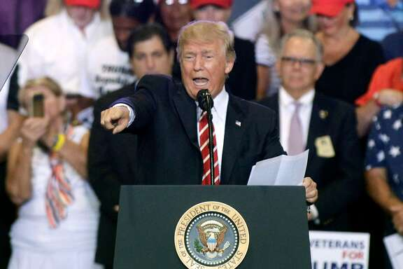 PHOENIX, AZ - AUGUST 22:  U.S. President Donald Trump speaks to supporters at the Phoenix Convention Center during a rally on August 22, 2017 in Phoenix, Arizona. An earlier statement by the president that he was considering a pardon for Joe Arpaio,, the former sheriff of Maricopa County who was convicted of criminal contempt of court for defying a court order in a case involving racial profiling, has angered Latinos and immigrant rights advocates.  (Photo by Ralph Freso/Getty Images)