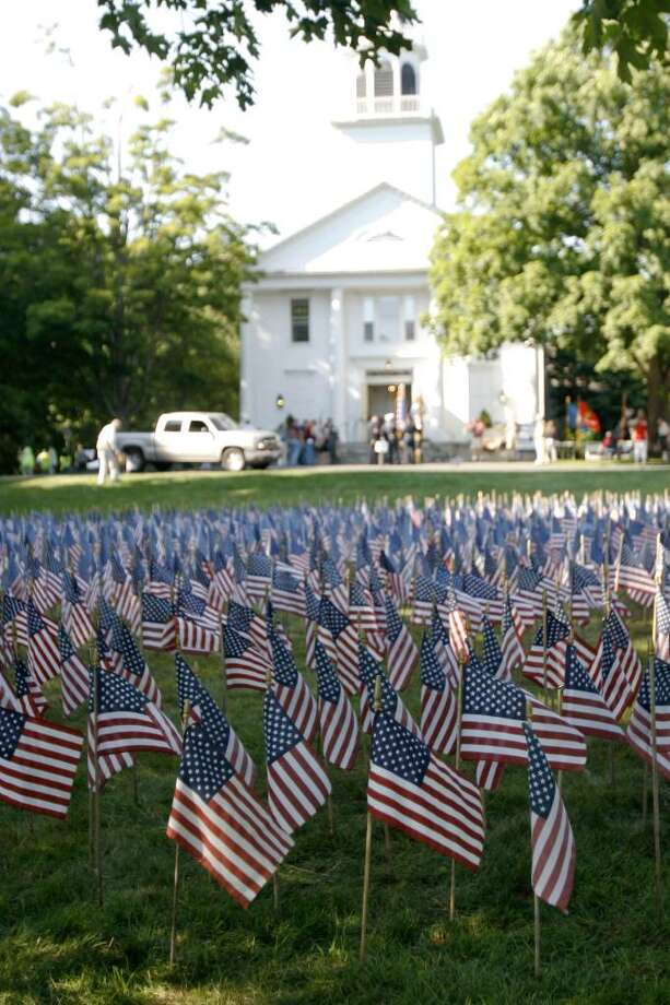 The Field of Flags on the lawn of Saugatuck Congregational Church in Westport on Friday, June 18, 2010. Each individual flag honors a fallen soldier. Photo: Laura Buckman / Connecticut Post