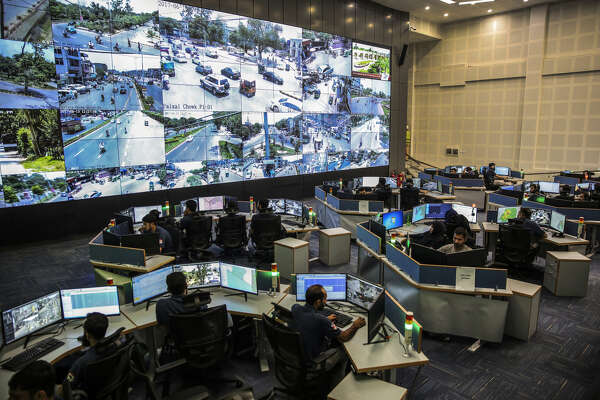 Police officers watch live video feeds at the Punjab Police Integrated Command, Control and Communication Center in Lahore, Pakitan, on June 13, 2017.