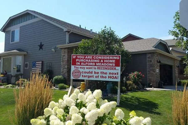 Richard Stephens erected this sign after his homeowners association told him he had too many decorations in his front yard.