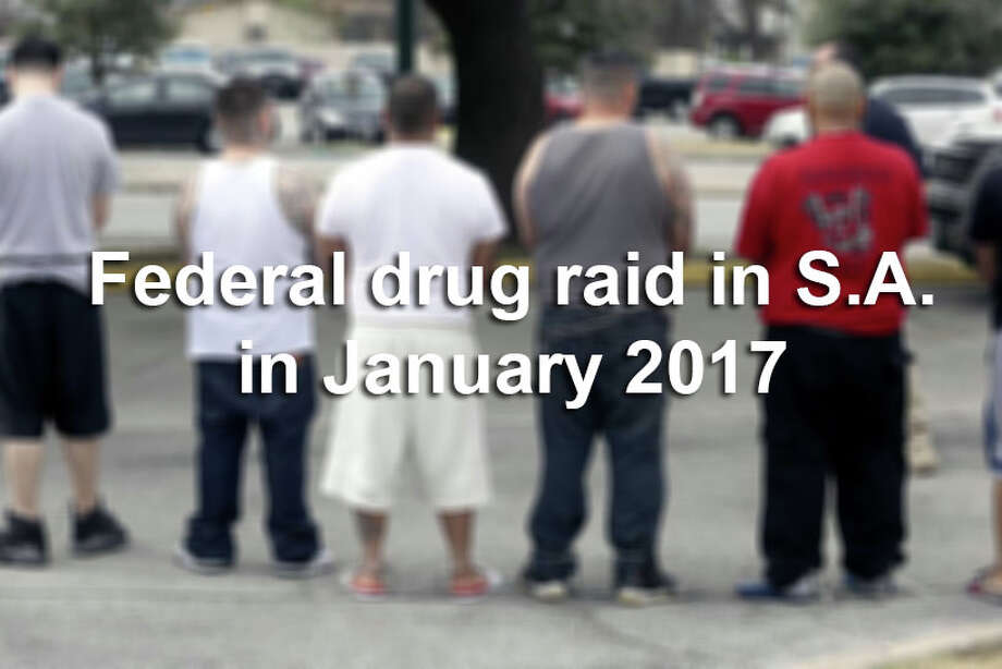 Law officers raided several locations Thursday, Jan. 12, 2017, in and around San Antonio as part of an operation targeting a ring accused of distributing large quantities of methamphetamine and cocaine. Many of the suspects are with the Tango Orejon/Tango Blast gang, sources said. Photo: William Luther/San Antonio Express-News