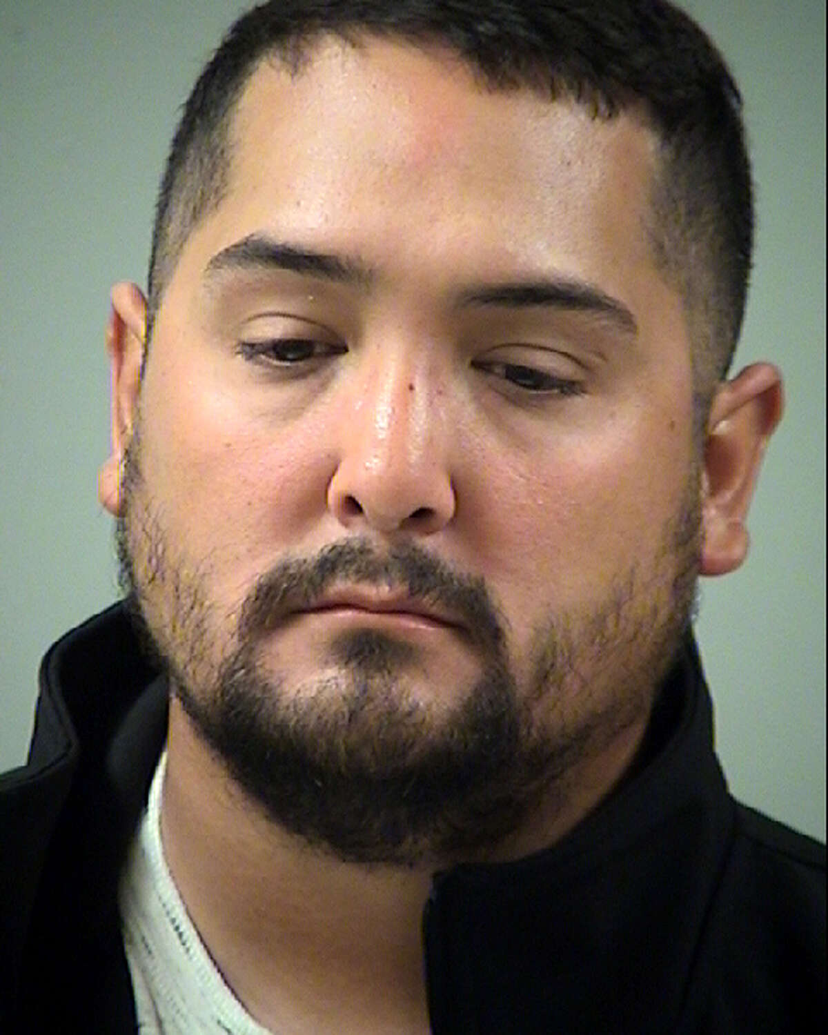 Garrett Flores, 31, surrendered his law enforcement license in return for prosecutors dismissing his official oppression charge.