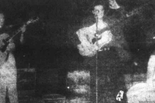 From left, Scotty Moore, Elvis Presley and Bill Black play on the Conroe High School football field on Aug. 23, 1955. The group was a part of the Louisiana Hayride tour.