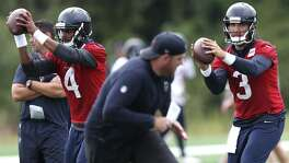 Houston Texans quarterback Deshaun Watson (left) and Tom Savage take shotgun snaps during training camp at The Greenbrier on Aug. 7 in White Sulphur Springs, W.Va.