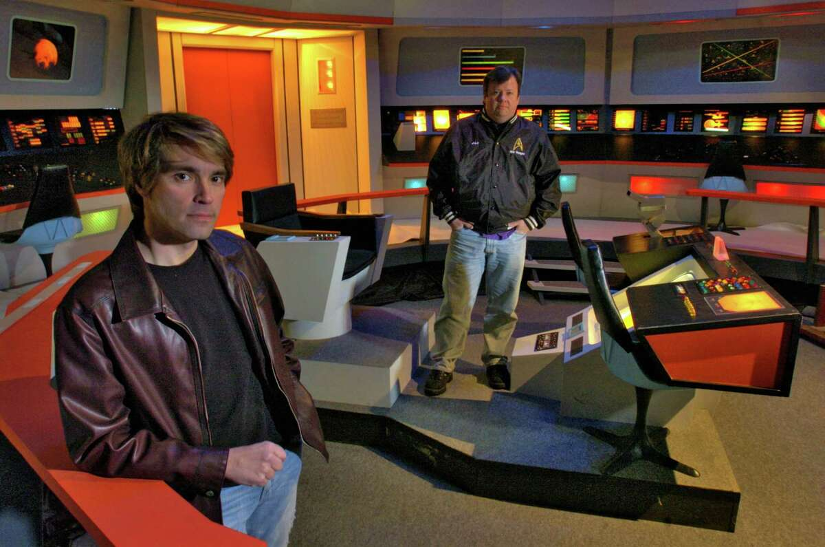 """Times Union Staff photograph by Philip Kamrass James Cawley, left, and James Lowe, right, stand on a reproduction of the starship Enterprise bridge set from the original Star Trek tv series from the 1960's, built in a former car dealership in Port Henry, NY Tuesday January 24, 2006. New episodes of the original show are being filmed on the set, available for free as downloads on the internet. Cawley plays Captain James T. Kirk, while Lowe is art director, for the show titled """"Star Trek New Voyages."""" Cawley estimates that he's invested over $100, 000 in the set."""