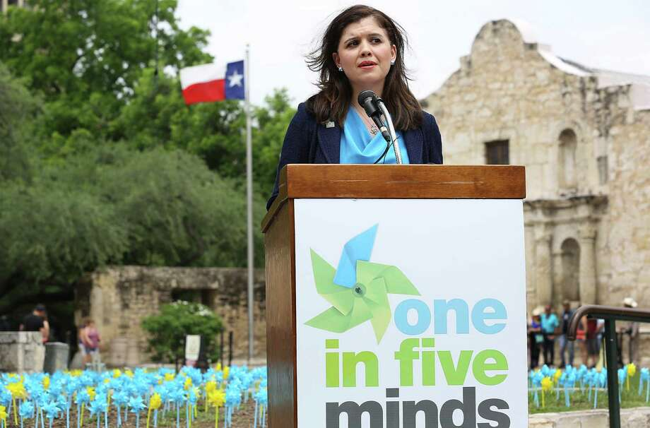 Justice Luz Elena Chapa speaks about her brother Michael who has struggled with schizophrenia, calling for more awarness about mental illnesses and seeking early treatment. For May Mental Health Awareness Month in 2015, 3,000 pinwheels were placed on the battleground of The Alamo serving as symbols of hope for children suffering from mental illness. Photo: Bob Owen /San Antonio Express-News / San Antonio Express-News