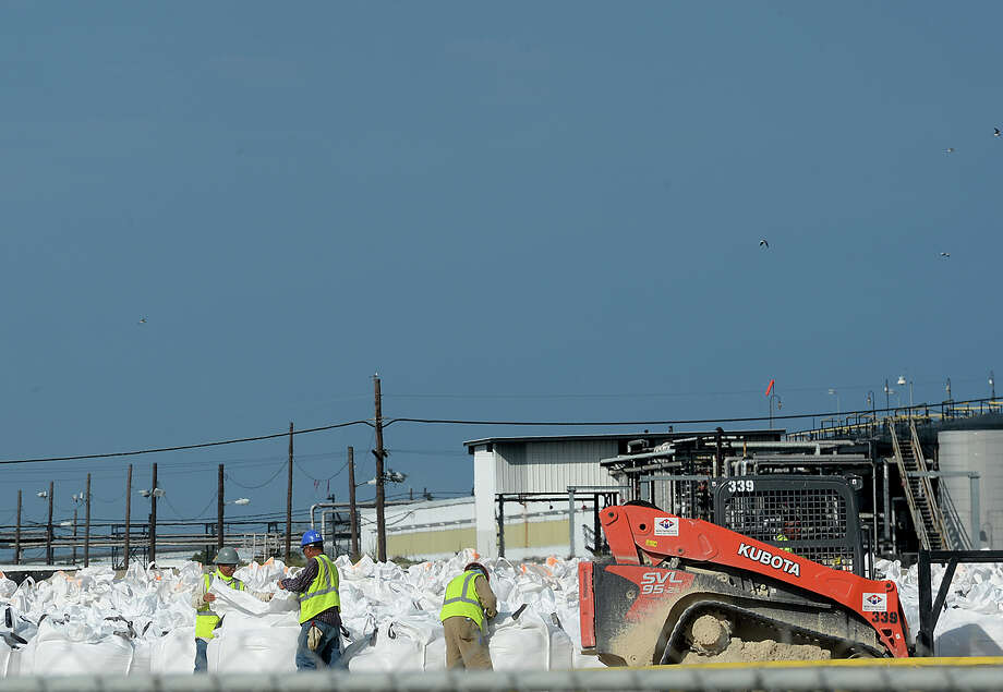With tropical storm Harvey's conditions building near the Gulf, work crews are busy stabilizing the damaged levee in Port Arthur. Further down the canal, super soaker sandbags were being filled and loaded onto barges to help shore up the levee and waterway should severe weather hit the area. Photo taken Tuesday, August 22, 2017 Kim Brent/The Enterprise Photo: Kim Brent / BEN
