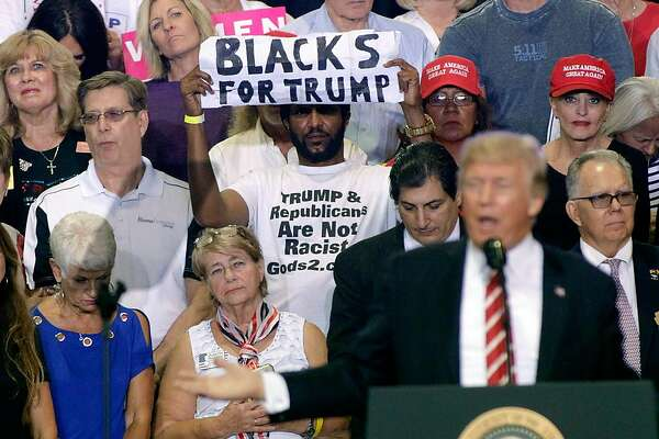 PHOENIX, AZ - AUGUST 22:  A supporter of U.S. President Donald Trump holds up a sign as the president speaks to a crowd at the Phoenix Convention Center during a rally on August 22, 2017 in Phoenix, Arizona.  (Photo by Ralph Freso/Getty Images)