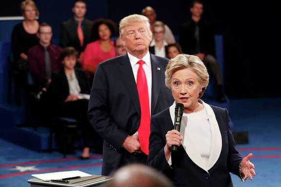 Democratic presidential nominee Hillary Clinton, right, speaks as Republican presidential nominee Donald Trump listens during the second presidential debate at Washington University in St. Louis, Sunday, Oct. 9, 2016. (Rick T. Wilking/Pool via AP)