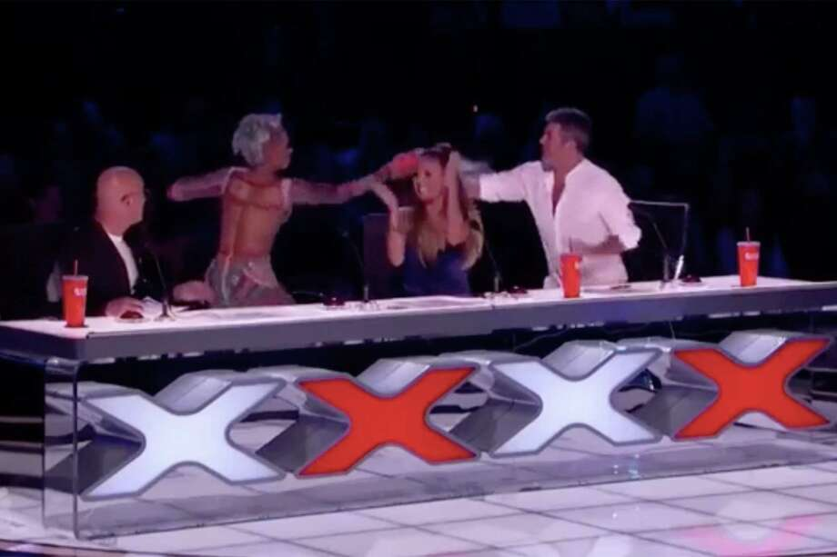 Mel B storms off America's Got Talent stage over Simon Cowell's marriage jibe