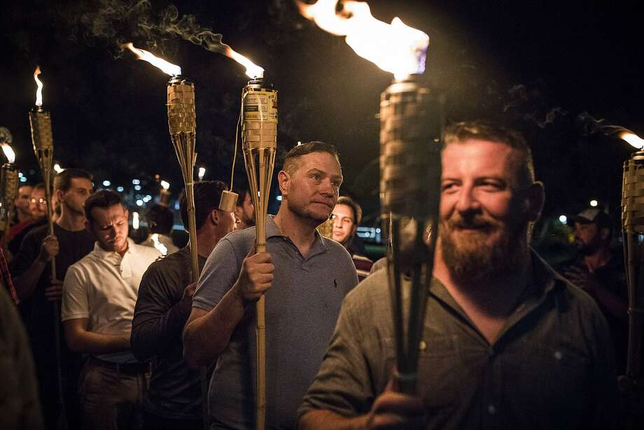 A torch-lit march by white nationalists through the grounds of the University of Virginia in Charlottesville, Va., Aug. 11, 2017. Photo: EDU BAYER, NYT