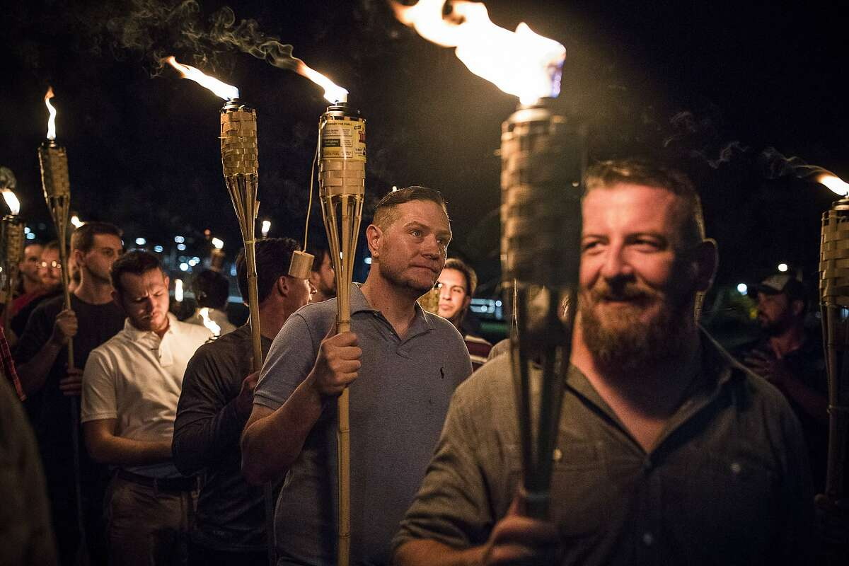 A torch-lit march by white nationalists through the grounds of the University of Virginia in Charlottesville, Va., Aug. 11, 2017.