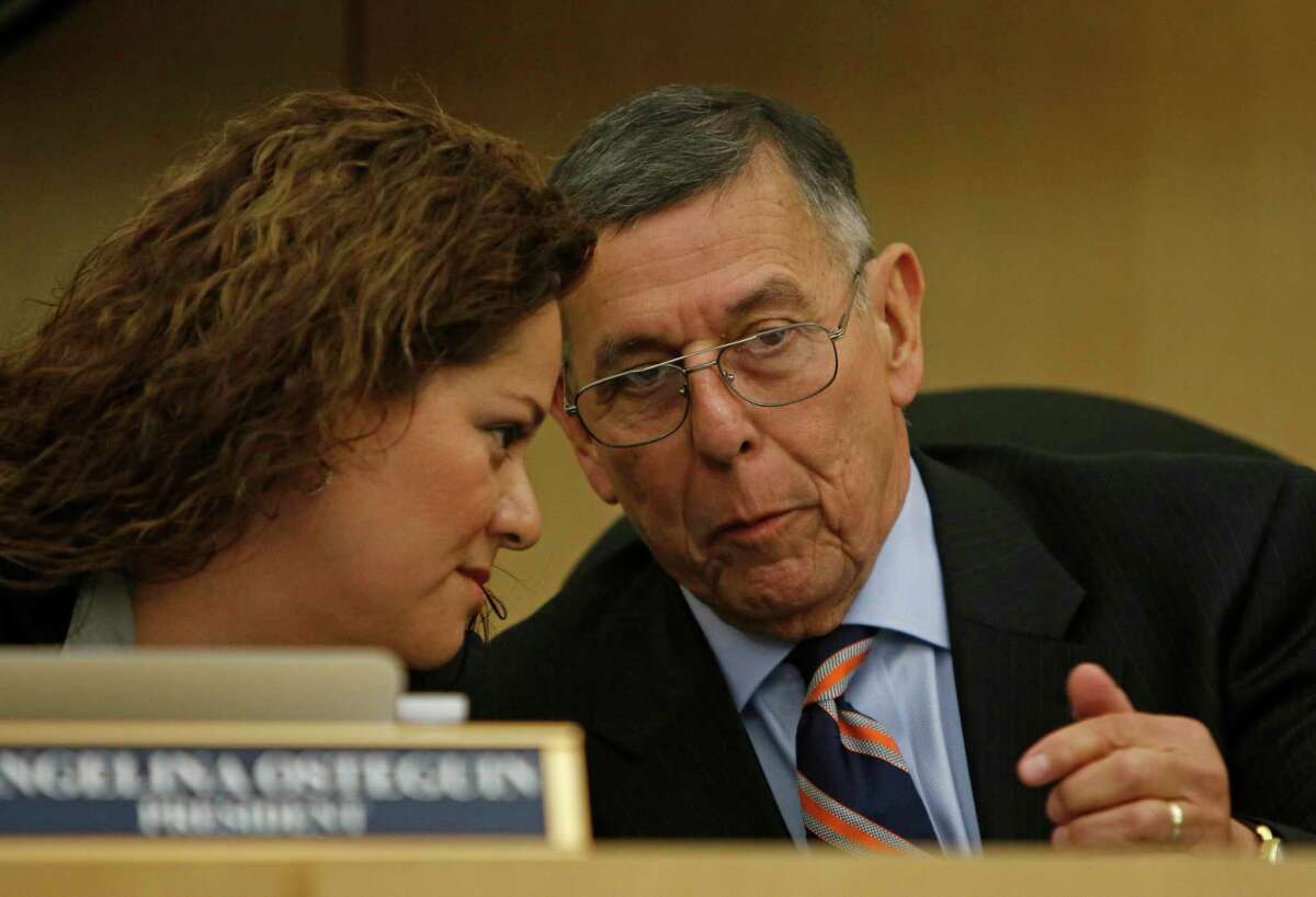Board president Angelina Osteguin confers with Superintendent Abelardo Saavedra at a South San ISD board meeting in 2017. Now both are on the boards of applicants who want to open charter schools in the area.