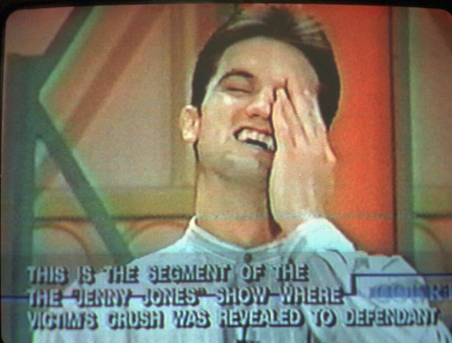 """FILE — Jonathan Schmitz reacts after finding out his secret admirer is Scott Amedure in this image taken from video shown to jurors in Schmitz's first-degree murder trial in Pontiac, Mich., Thursday, Oct. 17, 1996. Prosecutors say that Schmitz was humiliated during a taping of the """"Jenny Jones Show,"""" after learning that his secret admirer was another man. Days later, they allege, he shot and killed Amedure. (AP Photo/Court TV) Photo: AP / 1996 AP"""