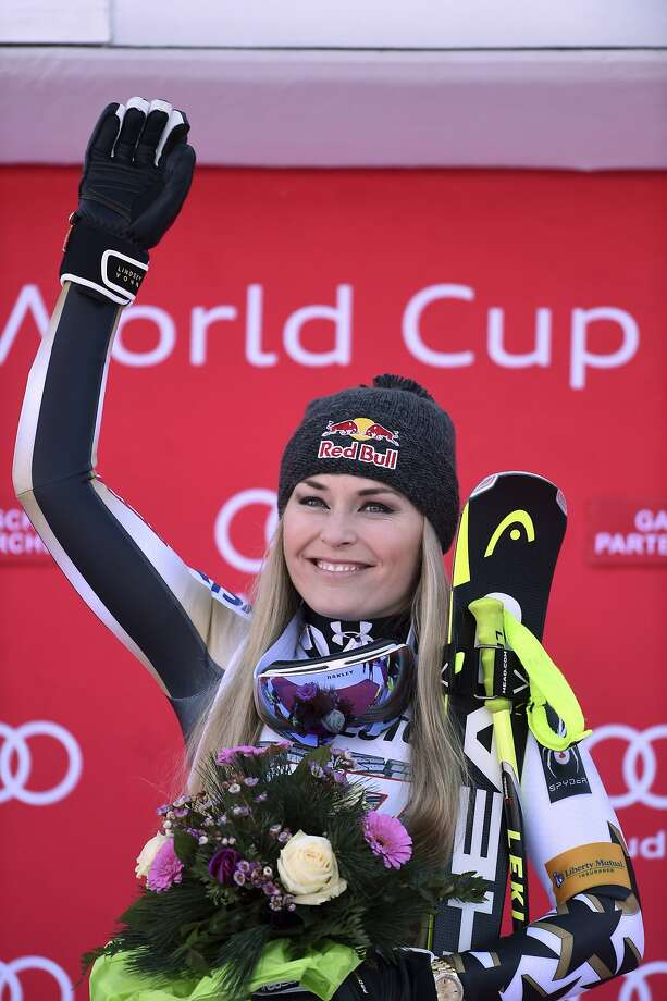 United States' Lindsey Vonn celebrates on the podium after winning an alpine ski, women's World Cup downhill, in Garmisch-Panterkirchen, Germany, Saturday, Jan. 21, 2017. (AP Photo/Marco Tacca) Photo: Marco Tacca, Associated Press