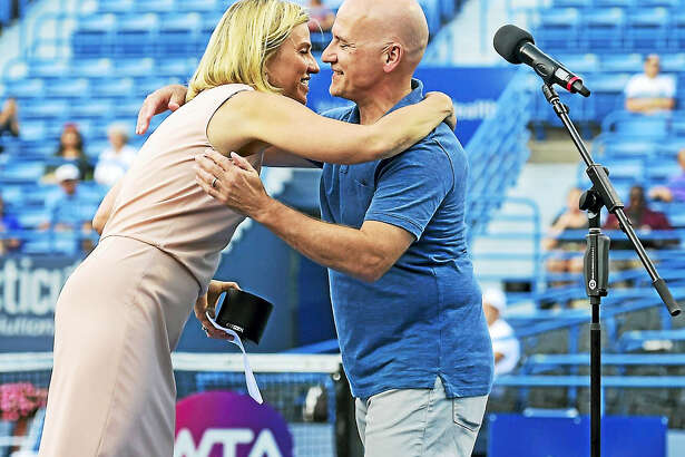 (Peter Hvizdak / Hearst Connecticut Media)   New Haven,Connecticut: Tuesday, August 22, 2017.   Connecticut Open tennis tournament director Anne Worcester, left, hugs Hartford Courant sports reporter Paul Doyle Monday evening on the Stadium Court of the Connecticut Tennis Center in New Haven after Doyle received the 2017 Connecticut Open Dave Solomon Media Award.
